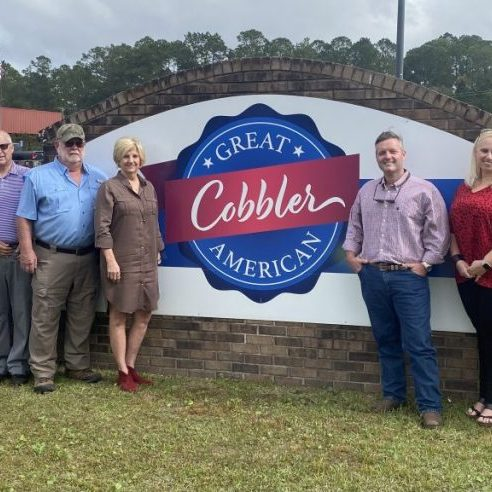Above are owners and financial partners in front of the new Great American Cobbler Company building in Homerville, on Highway 84 West.