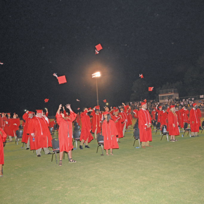 Members of the Clinch County High Class of 2020 celebrate after receiving their diplomas Friday at Donald Tison Field.
