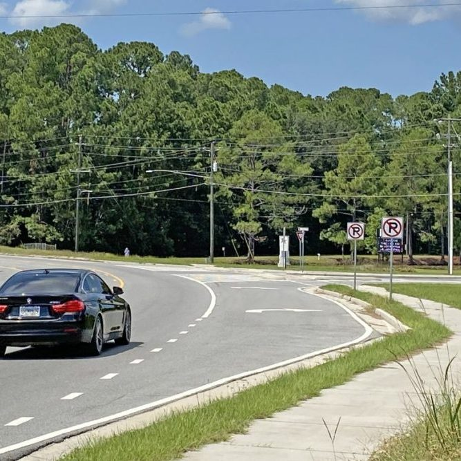 A vehicle travels in front of Clinch County High School on Highway 441 (North Church Street), where the LIDAR camera measures speeds of motorists.